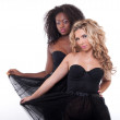 Two female models in a black transparent dress — Stock Photo #10757673