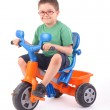Young boy riding his tricycle — Stock Photo