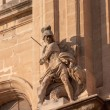 Statue of Saint Michael and the dragon - Stock Photo