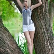 The girl on a tree at the river — Stock Photo