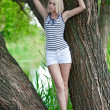 Stock Photo: The girl on a tree at the river