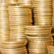 Piles of golden coins background — Stock Photo