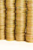 Cztery stosy monet złotych — Zdjęcie stockowe