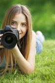 Beautiful young photographer — Stock Photo