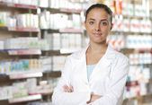 Portrait of Smiling Woman Pharmacist in Pharmacy — Stock Photo