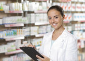 Portrait of Smiling Woman Pharmacist whit clipboard — Stock Photo
