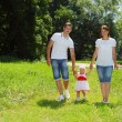 Happy family walking in park — Stock Photo #11559091