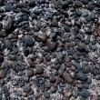 Volcanic black stones on the beach — Stock Photo