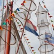 Fishing ship decorated with nets and flags from holland and fish - Stock Photo