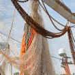 Nets of Dutch fishing cutter hanging out to dry - Stock Photo
