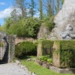 Ornamental garden near an old castle ruins - Stock Photo
