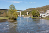 River Meuse near Dinant in Belgium, a highway is crossing te riv — Stock Photo