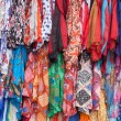 Colorful clothes for sale at a market — Stock Photo