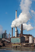 Steel factory with big chimneys in IJmuiden, the Netherlands — Stock Photo
