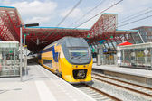A train is leaving the central station of Lelystad, the Netherla — Stock Photo