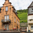 Traditional houses along the river Moselle in Germany with viney - Stock Photo