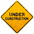 Stock Vector: Dirty Under Construction Sign