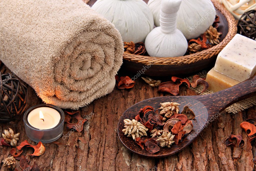 Spa massage setting with thai herbal compress stamps and candlelight  Stock Photo #11335029