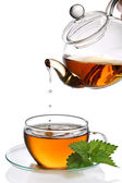Tea dripping into cup (clipping path) — Stock Photo