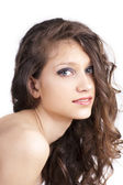Pretty young woman with curly hair — Stock Photo