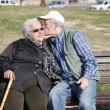 Elderly men kisses the old women - love concep — Stock Photo