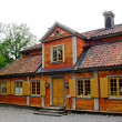 Swedish red and yellow cabin — Stock Photo