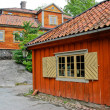 Swedish red and yellow cabin — Stock Photo #11741439