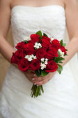 Bride showing her rose bouquet — Stock Photo
