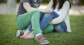 Young couple sitted on the grass — Stock Photo
