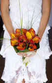 Bride showing her orchid bouquet — Stock Photo