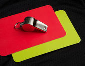Referee red card and whistle — Stock Photo