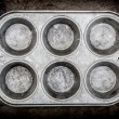 Muffin pan background — Stock Photo
