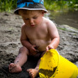 Child playing on beach with bucket — Stock Photo