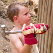 Boy helping hammer in nails — Stock Photo