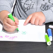 Child drawing. - Stock Photo