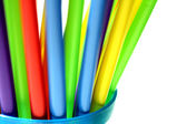 Bright Colorful Plastic Straws in Blue Cup — Stock Photo