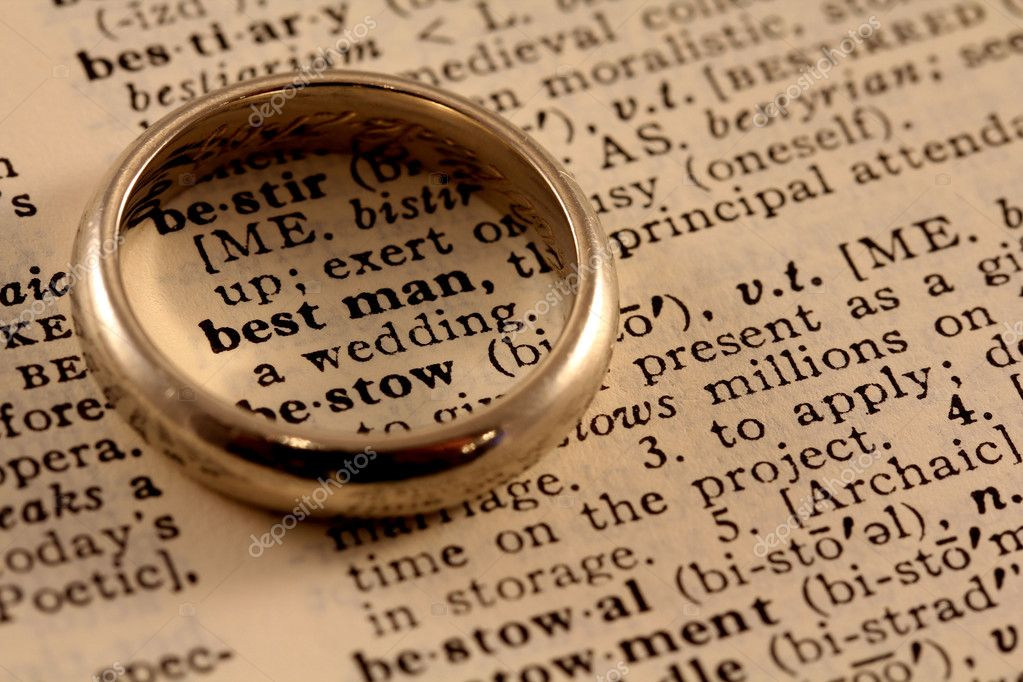 The words best man in the dictionary with a wedding ring atop, circling the words  Foto de Stock   #11594452