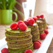 Nettle pancakes with raspberries - Stock Photo