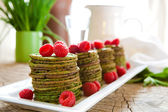 Nettle pancakes with raspberries — Stock Photo