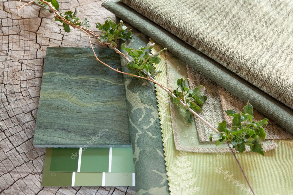 Green fabric swatches with paint color sample cards and a natural stone tile — Stock Photo #10768261