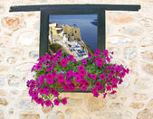 Traditional greek house through an old window in Santorini island, Greece — Stock Photo