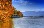 Landscape in fall autumn with boat in lake — Stock Photo