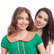 Two teenage girls smiling — Foto de Stock