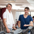 Royalty-Free Stock Photo: Gym training, young man and his father