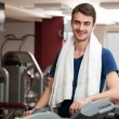 Stock Photo: Young mtraining in gym