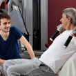 Stock Photo: Gym training, young mand his father