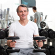 Постер, плакат: Man training in the gym
