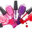 Ñolored nail polish  spilling from bottles - Stock Photo