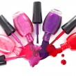 Ñolored nail polish spilling from bottles — Stock Photo