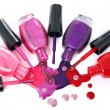 Stock Photo: Ñolored nail polish spilling from bottles